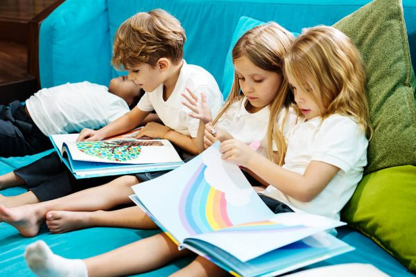 group-of-diverse-young-students-reading-children-s-PEXS9MS.jpg