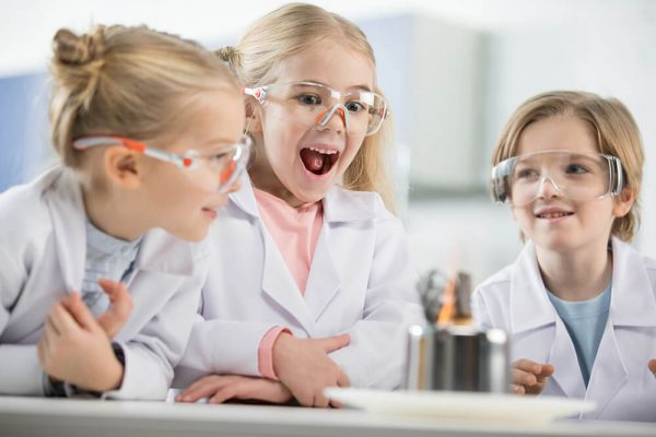 three-kids-wearing-protective-glasses-in-science-l-RTGFW2P.jpg